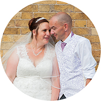 Wedding Couple's Portrait against Brick Building