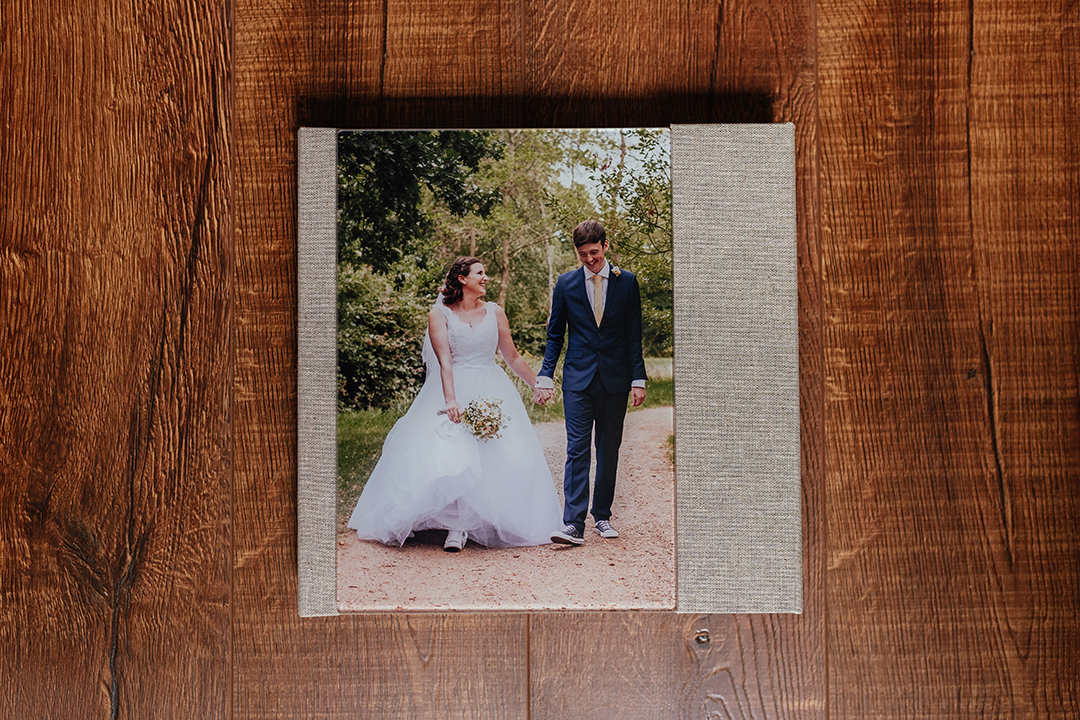 Legacy wedding album with linen cover and acrylic photo with magnetic clasp