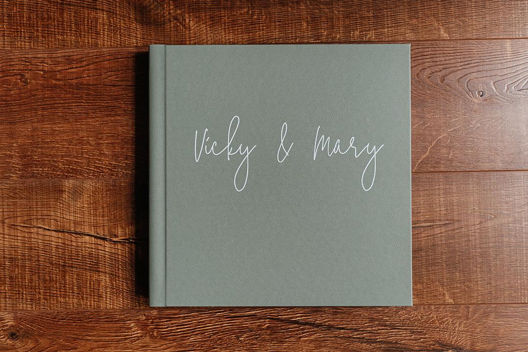 Importance of wedding albums - White wedding album with blue ribbon