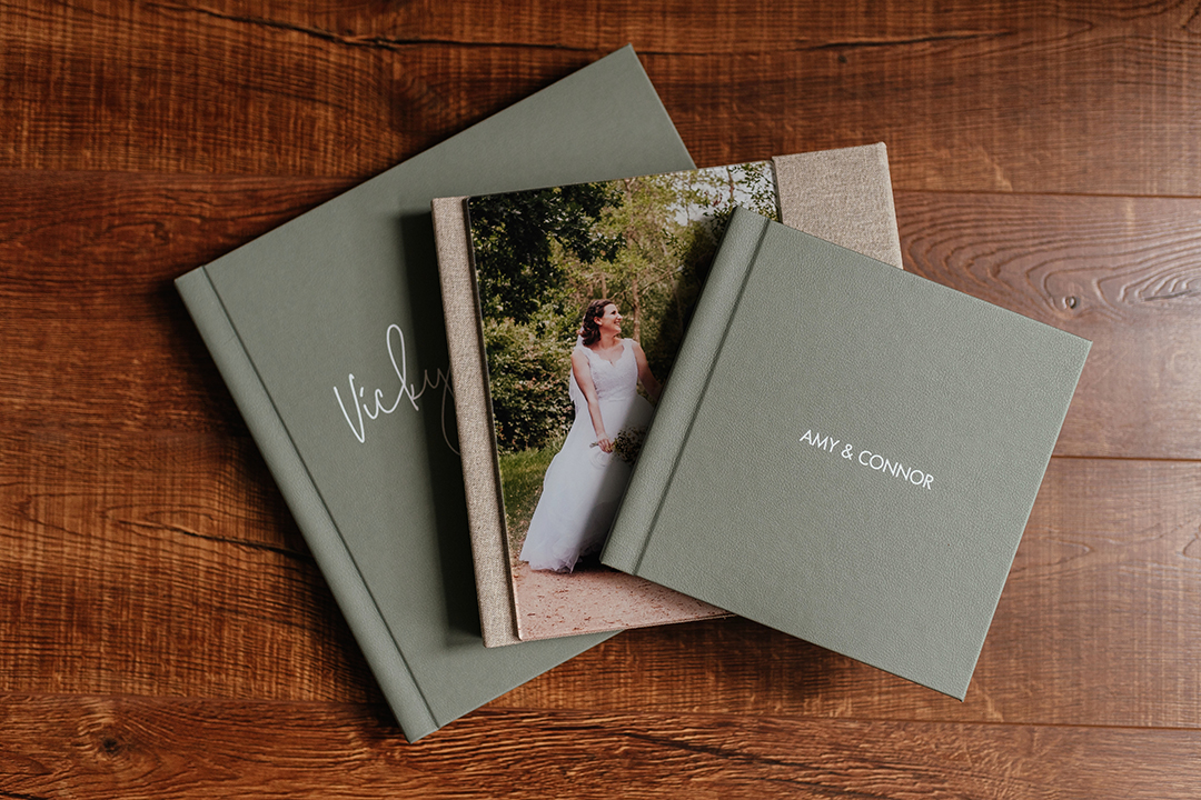 3 wedding albums laid in a fan shape