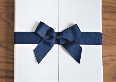 White-cover-with-blue-ribbon-wedding-album