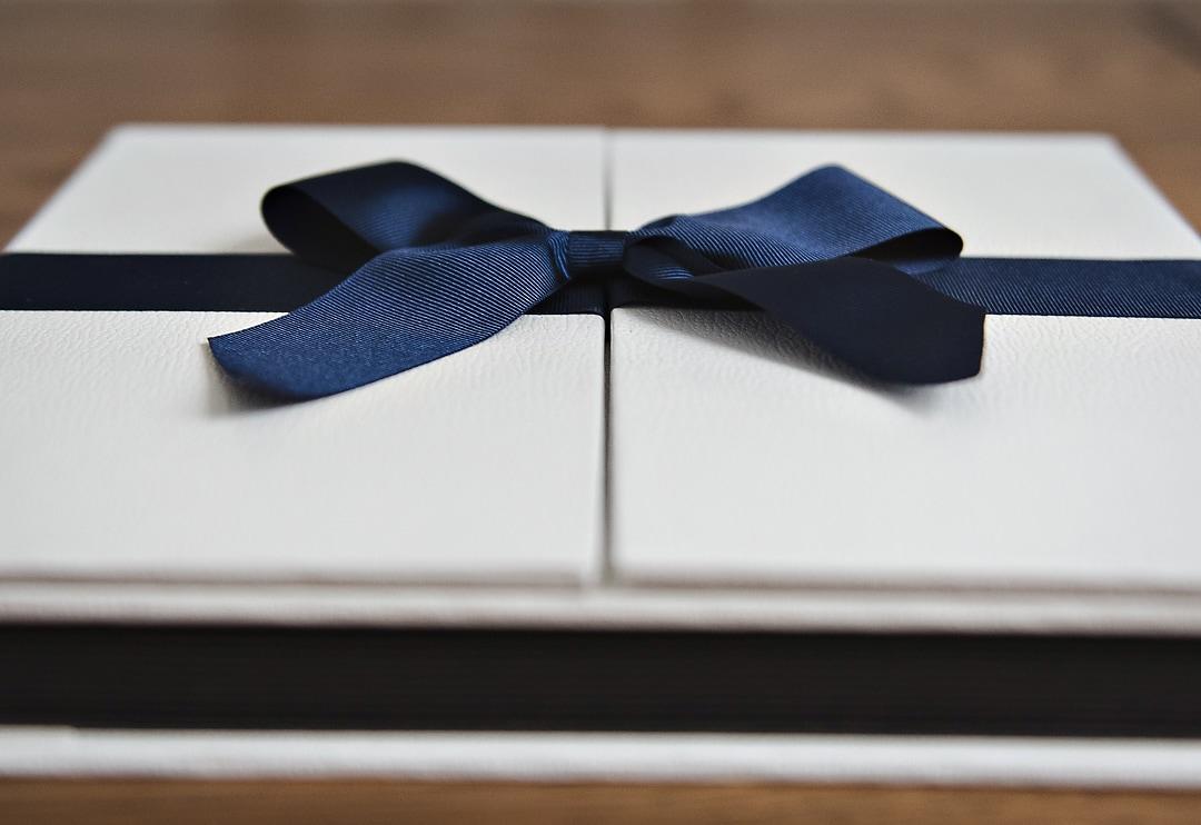 Wedding albums importance - white wedding album with blue ribbon