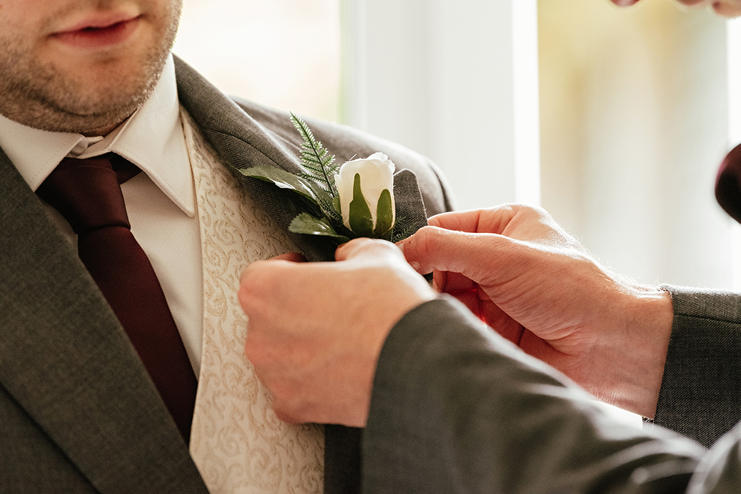 Best Man Attaches Buttonhole
