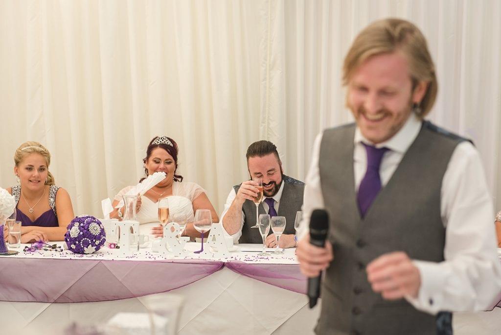 Essex wedding photographer captures Best mans speech at Parklands Quendon Hall Reception