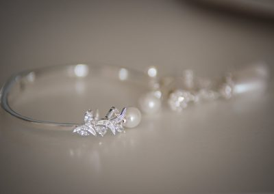 Bridal bracelet and earrings laid out