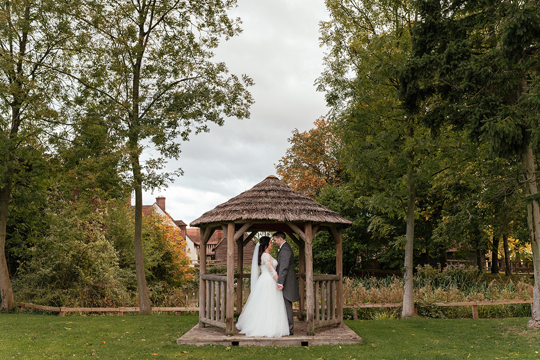Bridal and Groom Portraits Under Hut at Colville Hall
