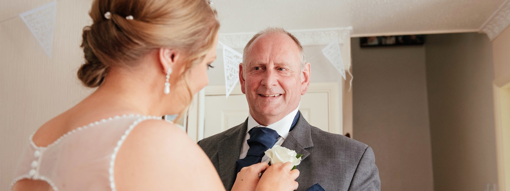 Bride helps father with button hole Essex Wedding