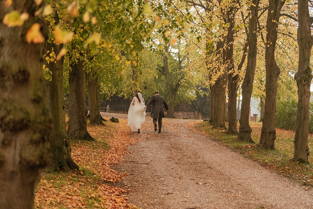 Bride and Groom Running out of rain Colville Hall Wedding