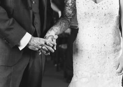 Bride and Groom hold hands in Bishops Stortford Wedding Ceremony