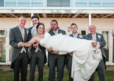Groomsmen Pick Up Bride for Comical Wedding Shot
