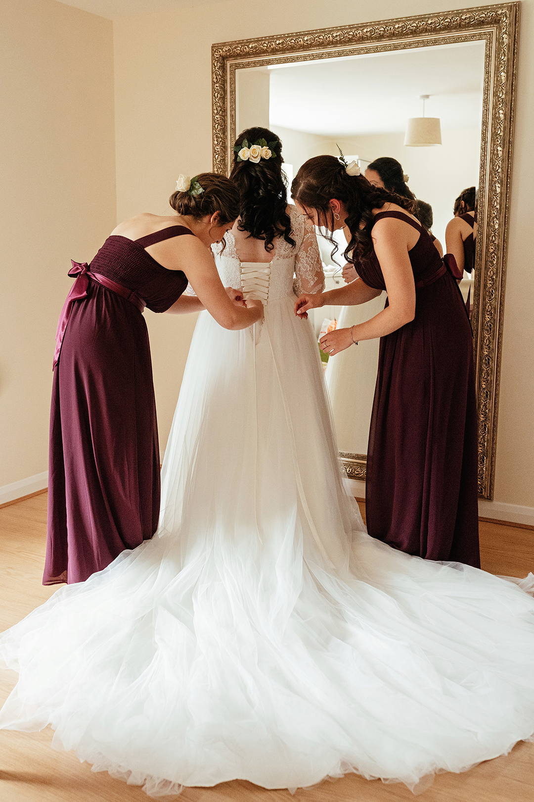 Bridesmaid Help Bride with Wedding Dress Colville Hall