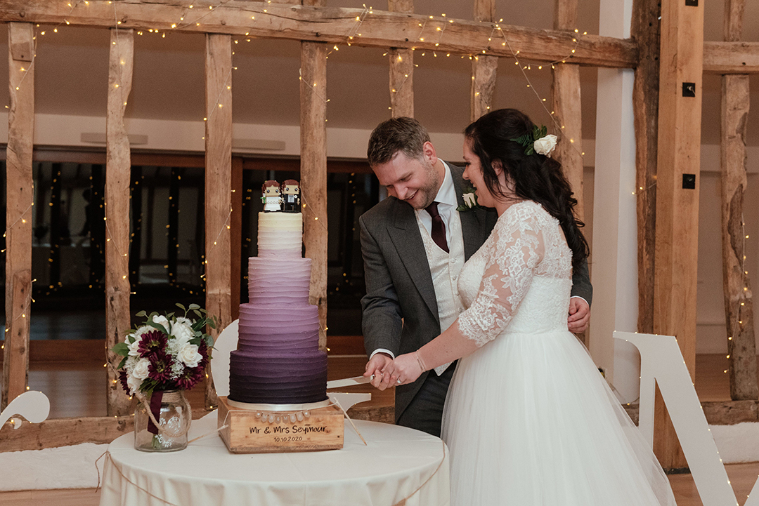Bride and Groom Cut Purple Gradient Cake at Colville Hall