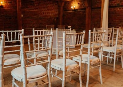 Close up of ceremony chairs in The Stable Barn at Tewin Bury Farm