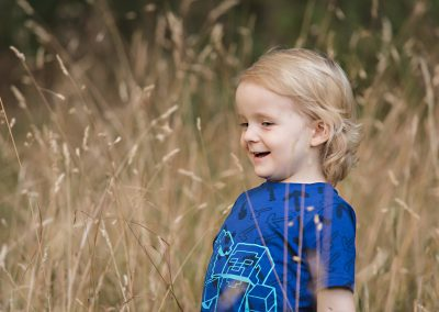 Childrens Photo shoot of boy in tall grass in Harlow Essex