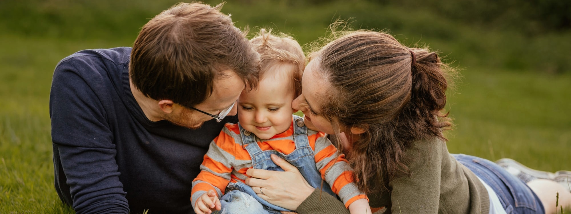 Family Get Close To Baby in Embrace Natural Family Photography Essex