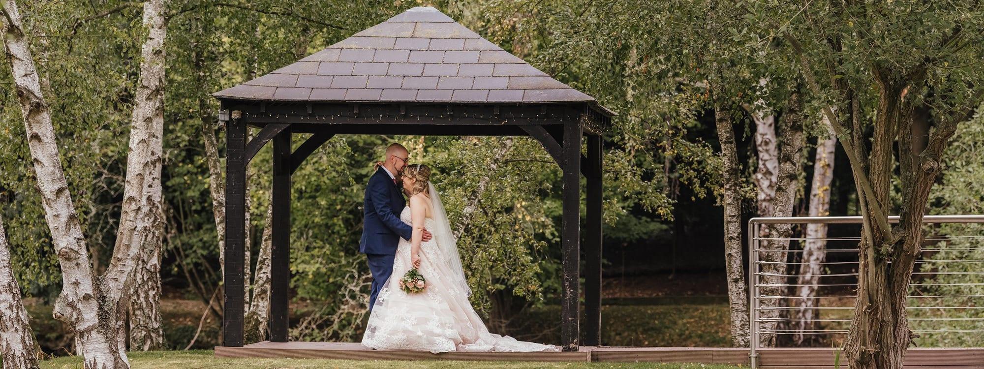 Couple Under Gazebo at Great Hallingbury Manor Essex Wedding