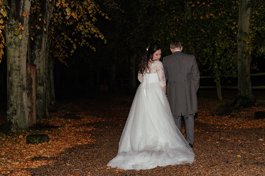 Night Portrait of Couple Walking Away from Camera in Autumn Colville Hall Wedding