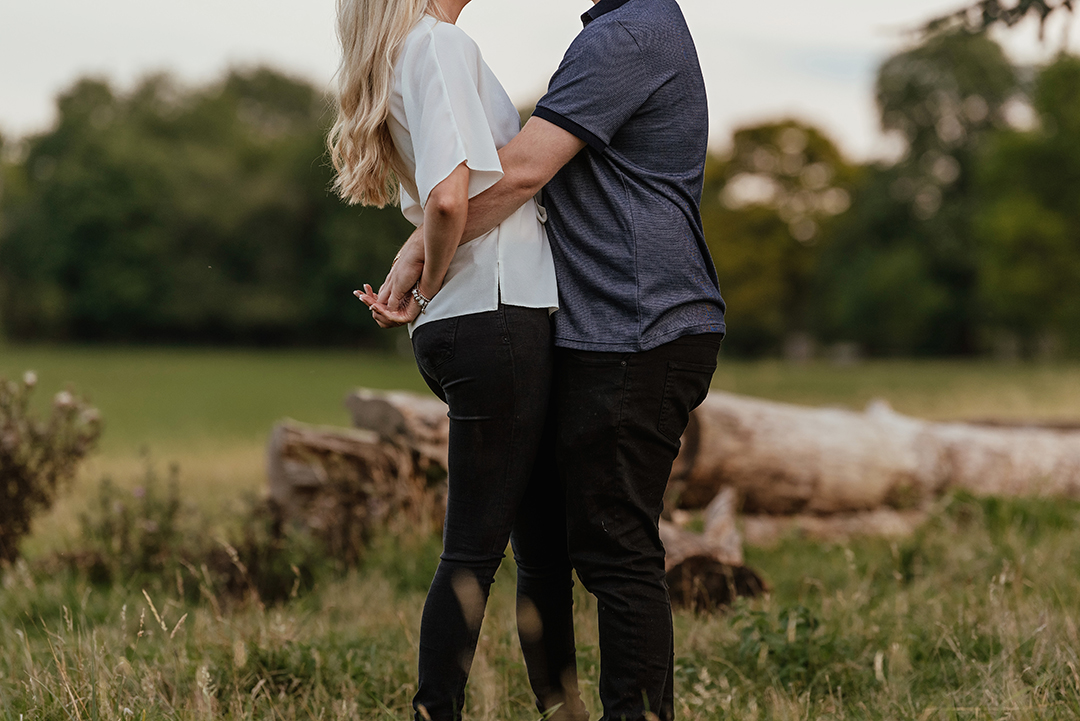 Couples middle as they embrace engagment photos
