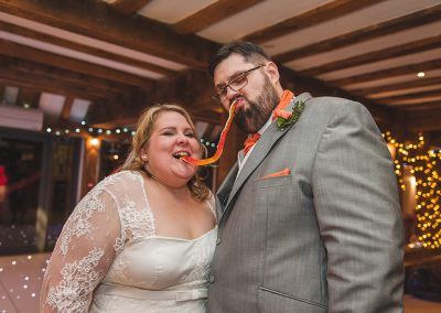 Cute Natural Fun Wedding photography of couple eating sweets