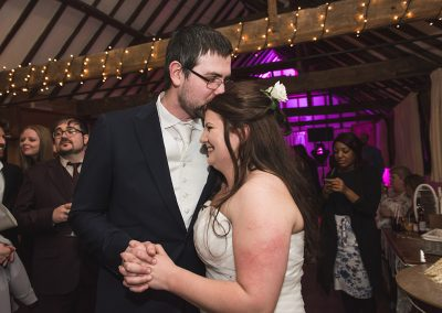 Natural moment between bride and groom after cake cutting as they embrace
