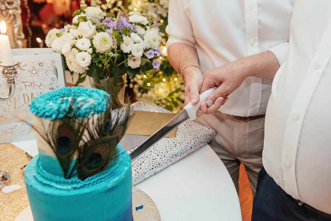 Cutting Peacock Wedding Cake