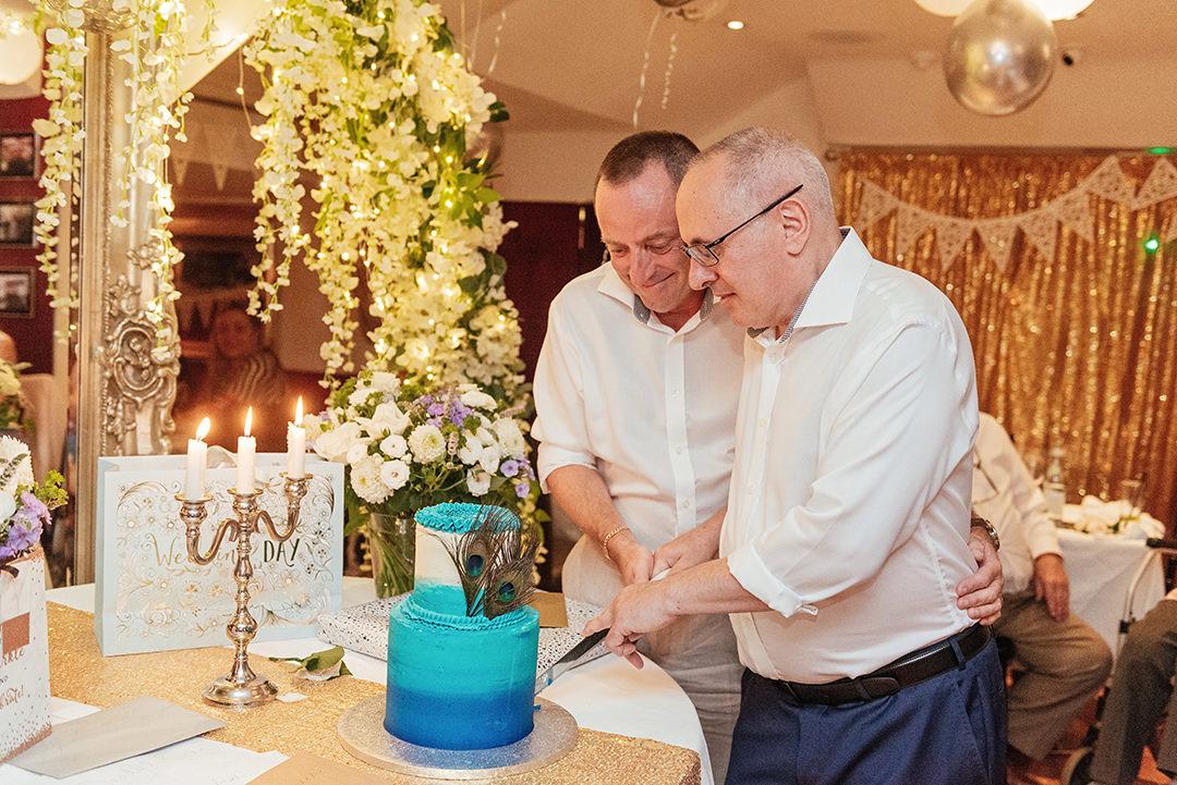 Groom's Cutting the Peacock Wedding Cake