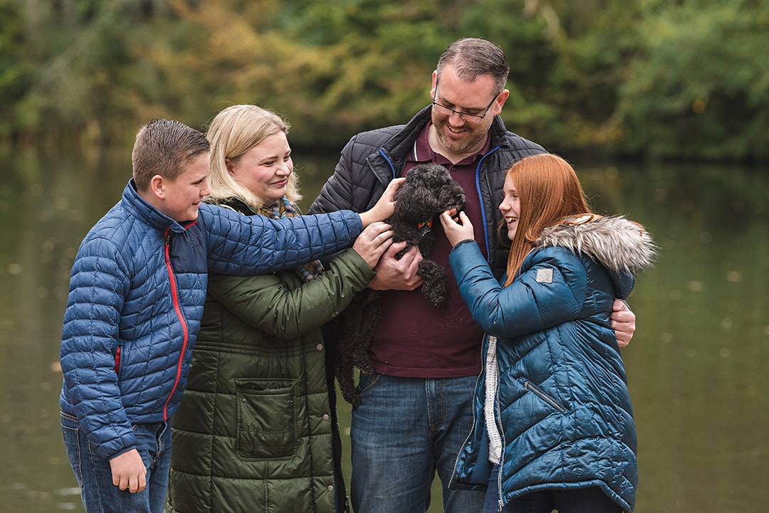 Close up of family fuss the dog in natural family photography