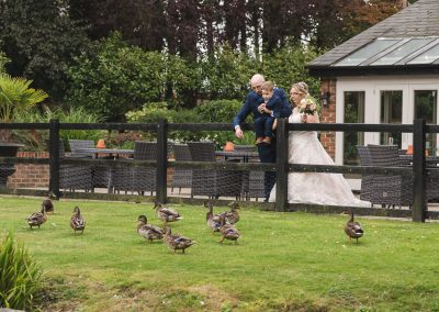 Feeding the ducks at Great Hallingbury Manor Wedding