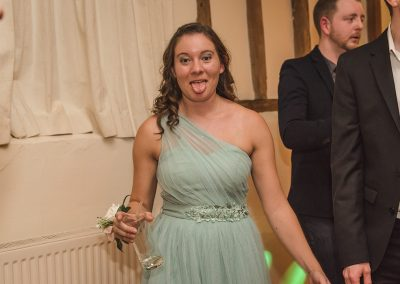 Pulling faces at the camera for fun wedding photography