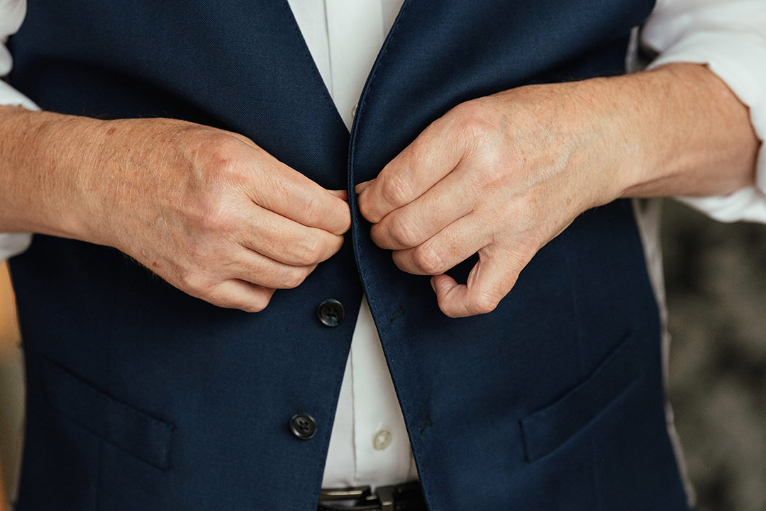 Groom Buttoning Navy Wasitcoat