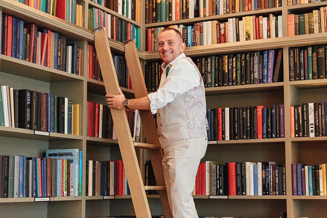 Groom on Ladder in Ham Yard Hotel Library