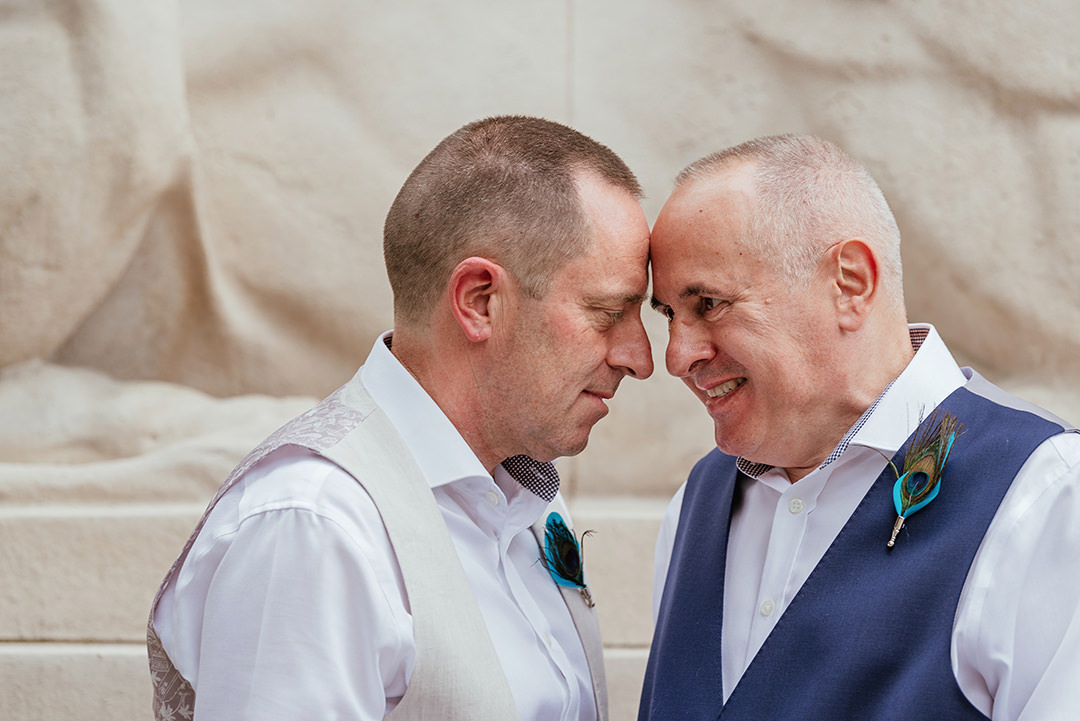 Grooms Heads together at Marylebone Town Hall