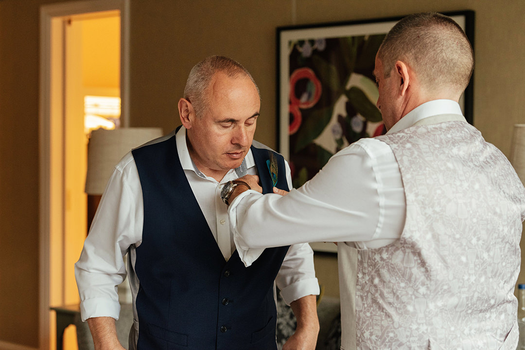 Grooms Putting On Buttonholes
