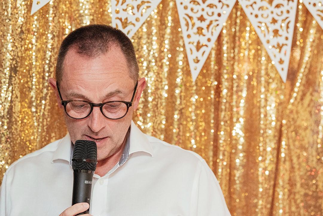 Grooms Speaking into Microphone