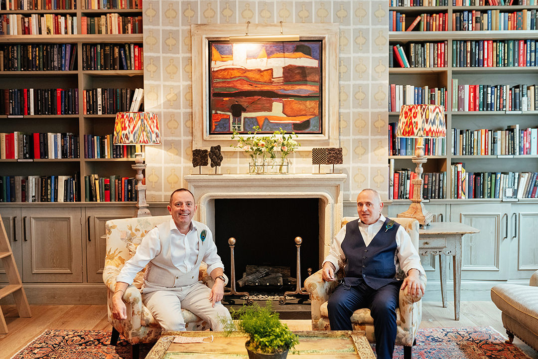 Grooms Sat together in Ham Yard Hotel Library
