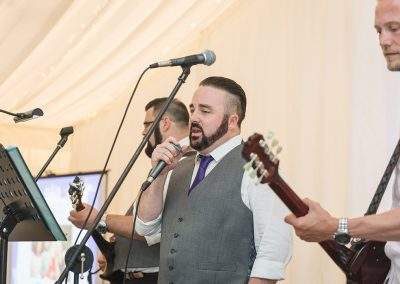 Groom singing to his new bride at Parklands Quendon Hall Wedding reception