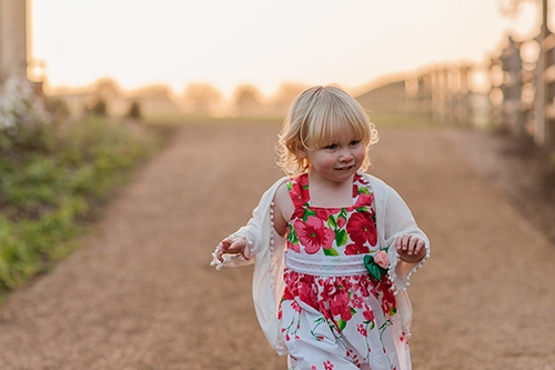 Little Girl runs towards camera at sunset, Harlow Essex Family Photography