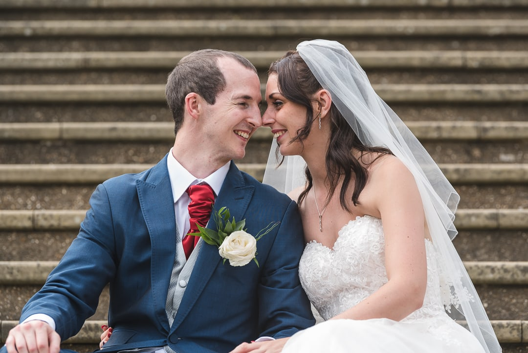 Couple touching noses in cute wedding photography moment at Hunton Park