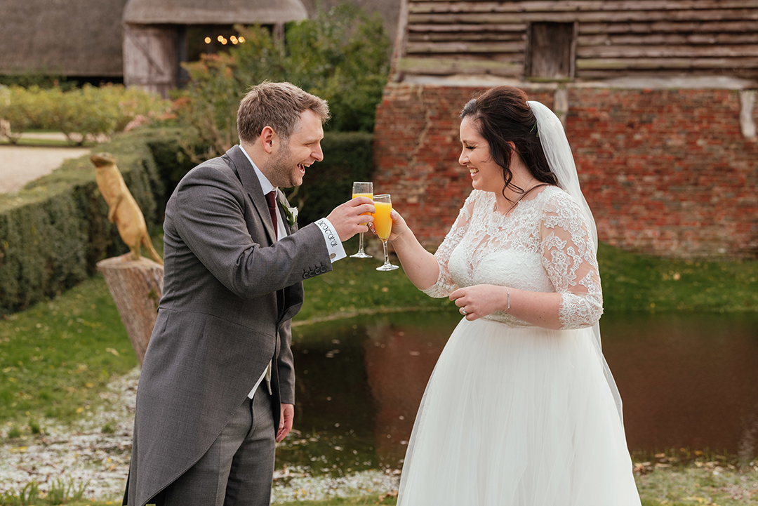 Bride and Groom Cheers Glasses after Wedding Ceremony at Colville Hall