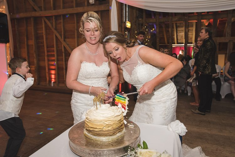 Essex wedding photographer captures Bride nearly drops rainbow slice of wedding cake!