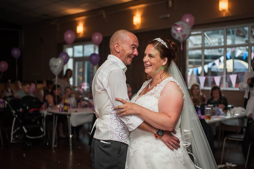 Couple laughing during their First Dance at Moot House in Harlow, Essex