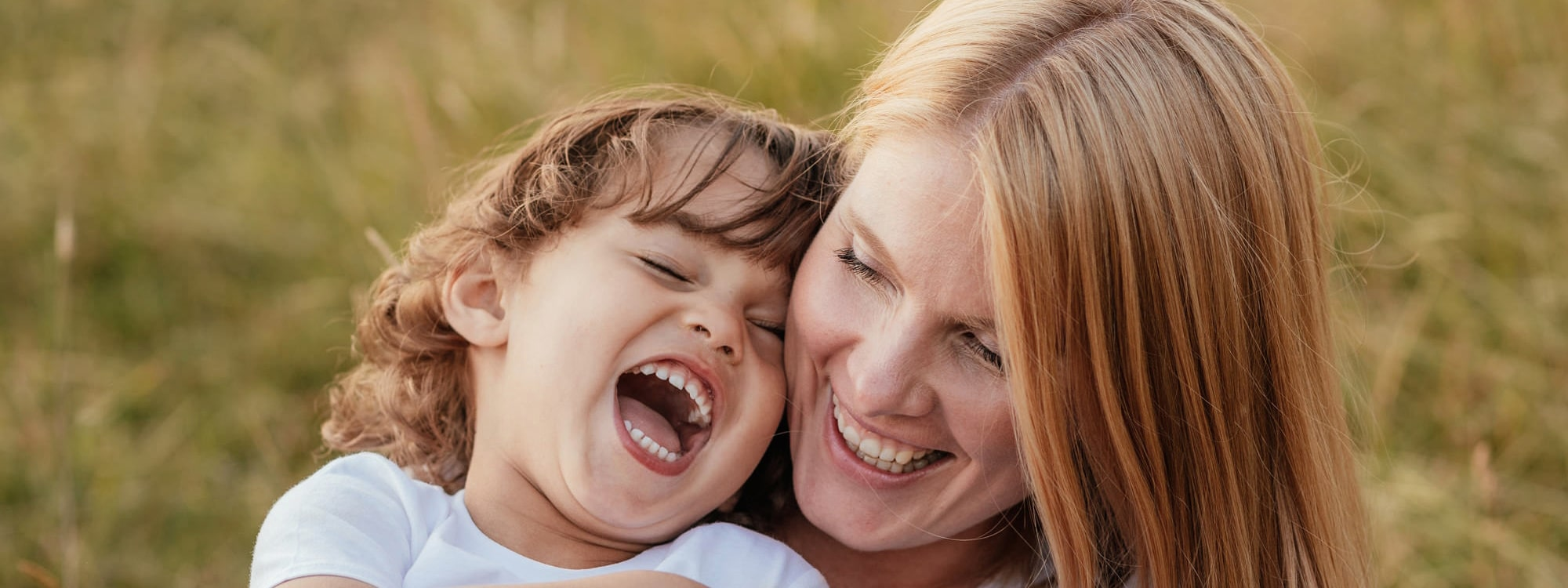 Mother and Son Embrace laughing in candid natural cute family photography essex