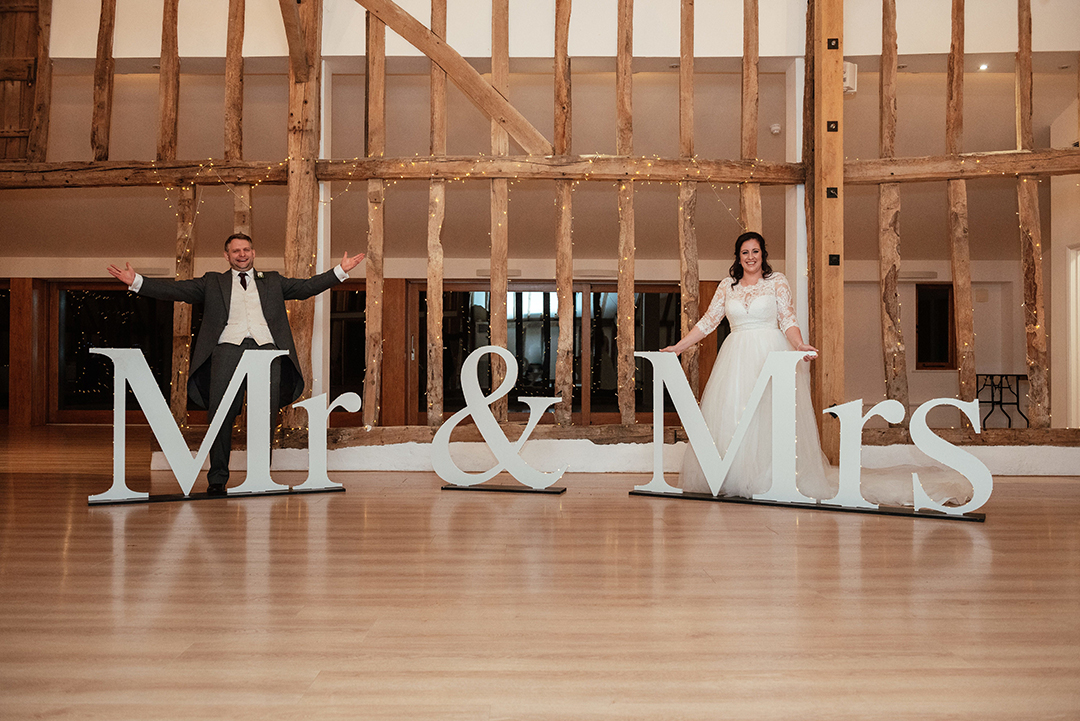 Couples Portraits in front of Mr and Mrs Signs at Colville Hall
