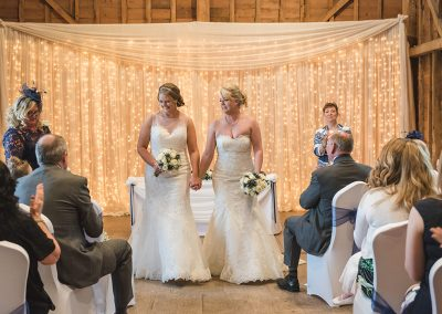 Two brides walk back down the aisle now wife and wife!