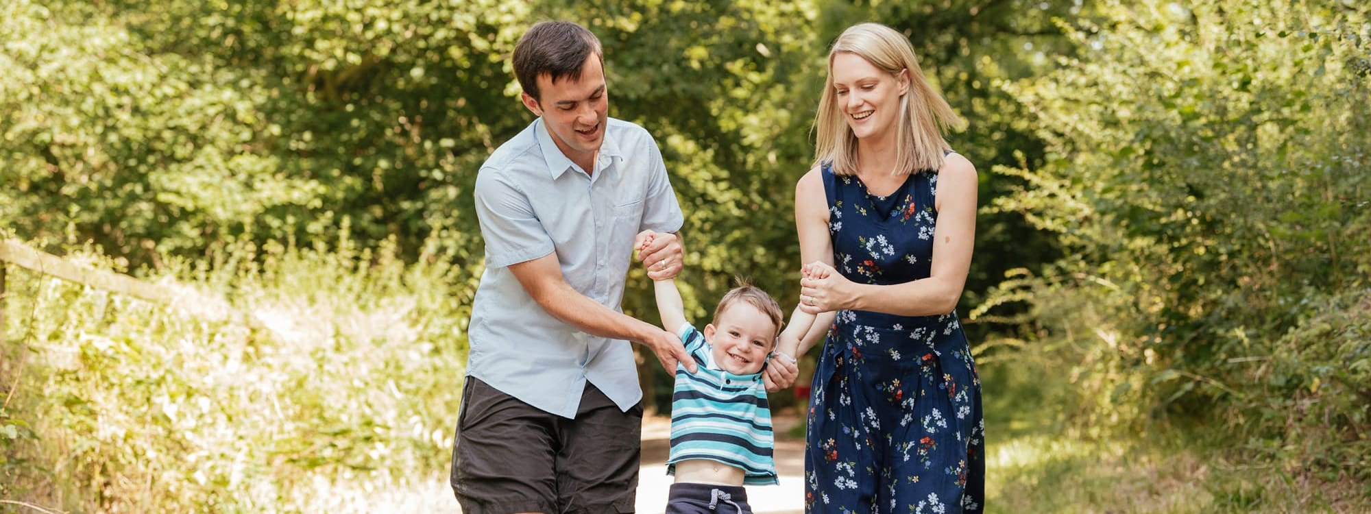 Family play with young son in Forrest in cute family photography Essex