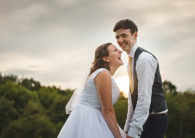 Natural Relaxed Couples Wedding Portrait laughing together at sunset
