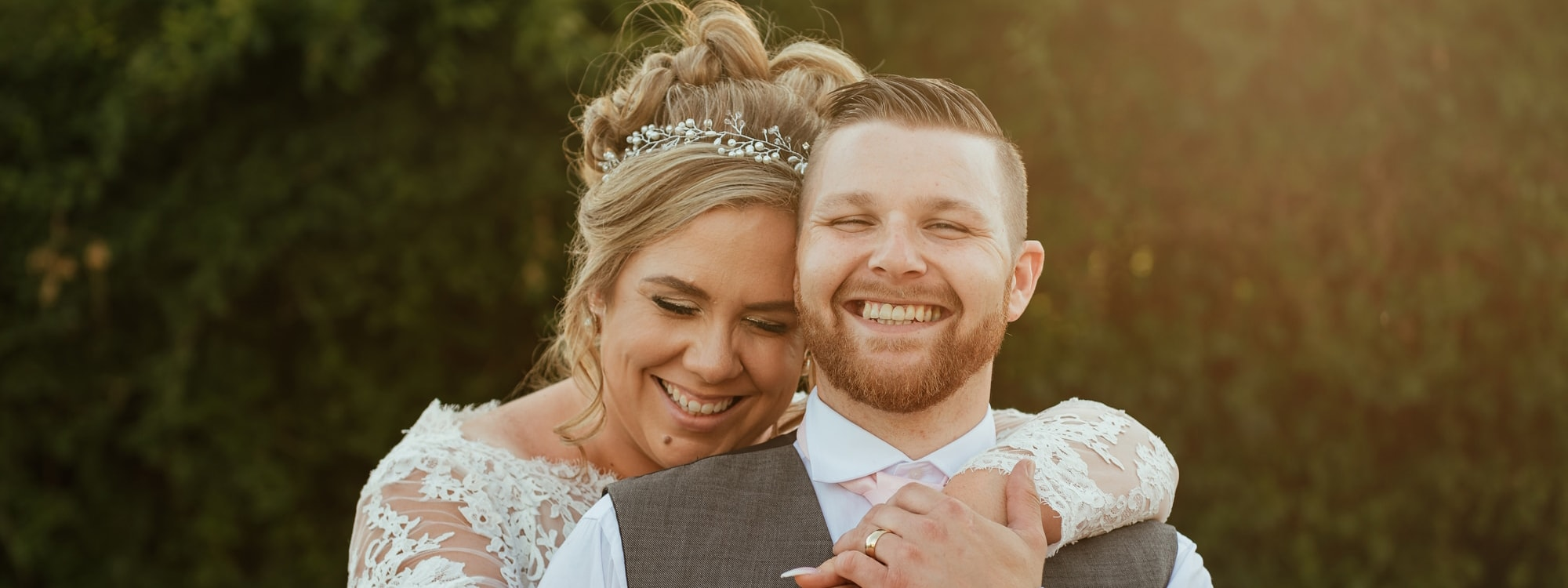 Couple Embrace and laugh together in Natural Wedding Photography Moment