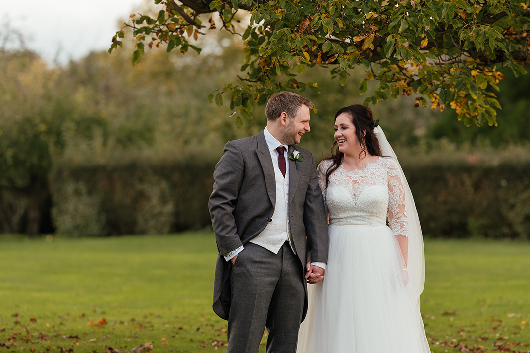 Natural shot of couple under Autumn leaves Wedding Photography Colville Hall