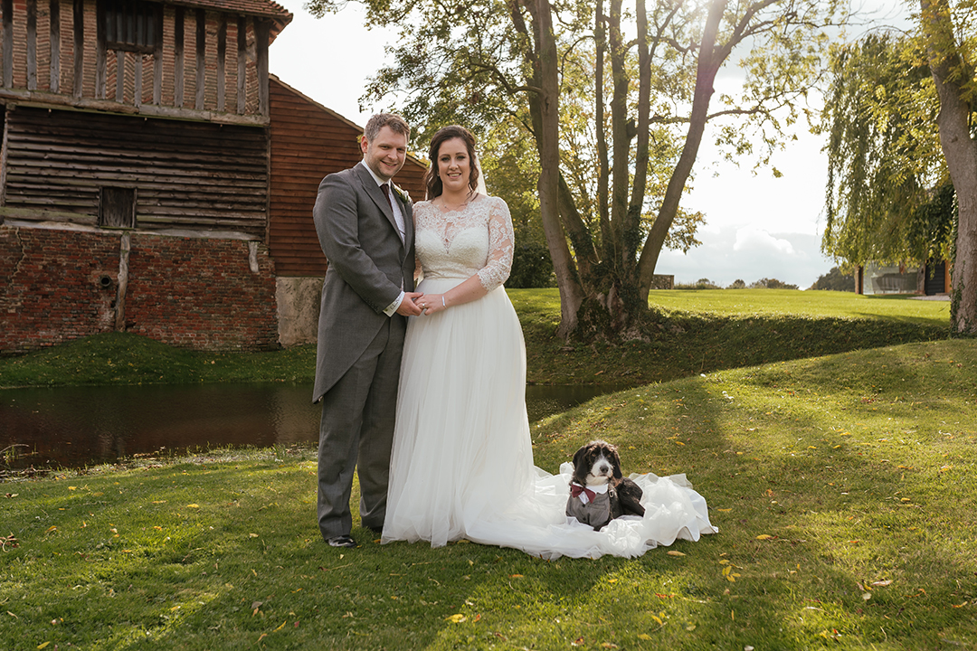 Portrait of the Bride and Groom as dog sits in Brides Dress at Colville Hall