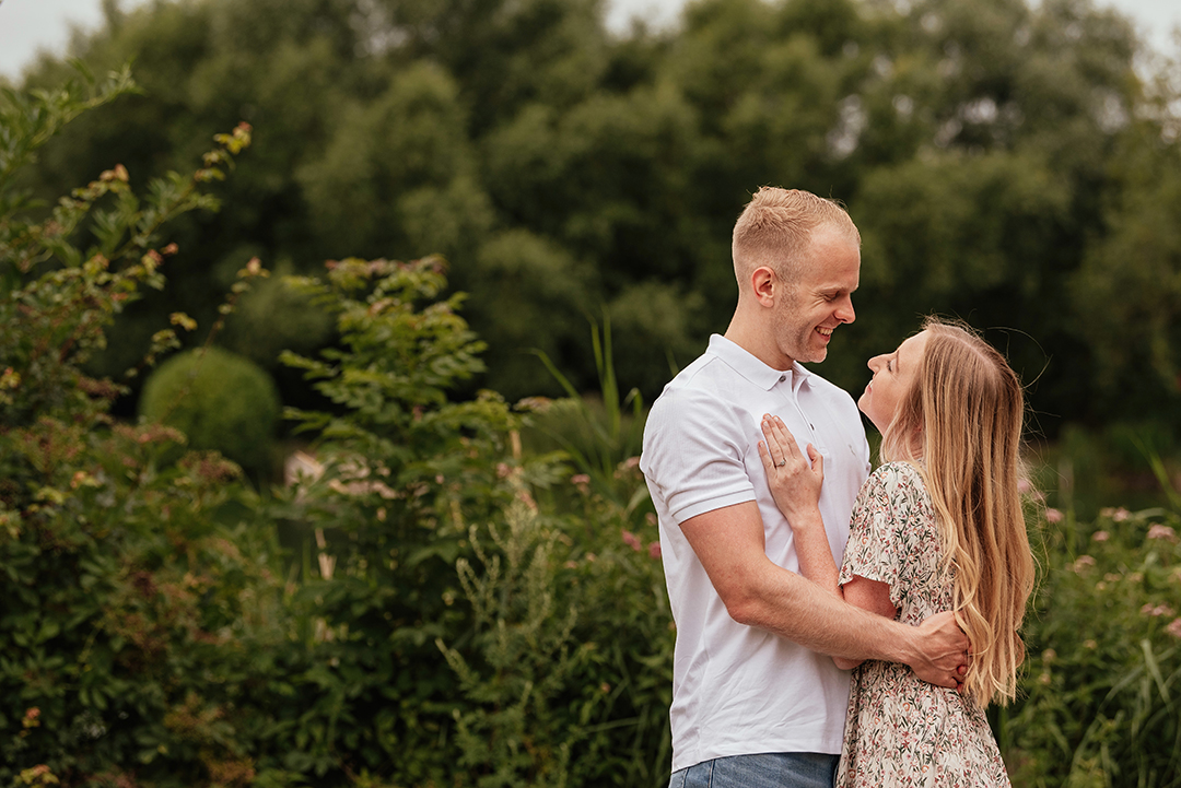 Couple embrace and laugh in Pre Wedding Photo Shoot at Stanborough Lake